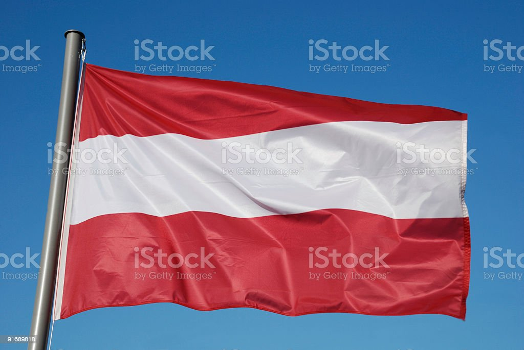 Austrian Flag with blue sky royalty-free stock photo