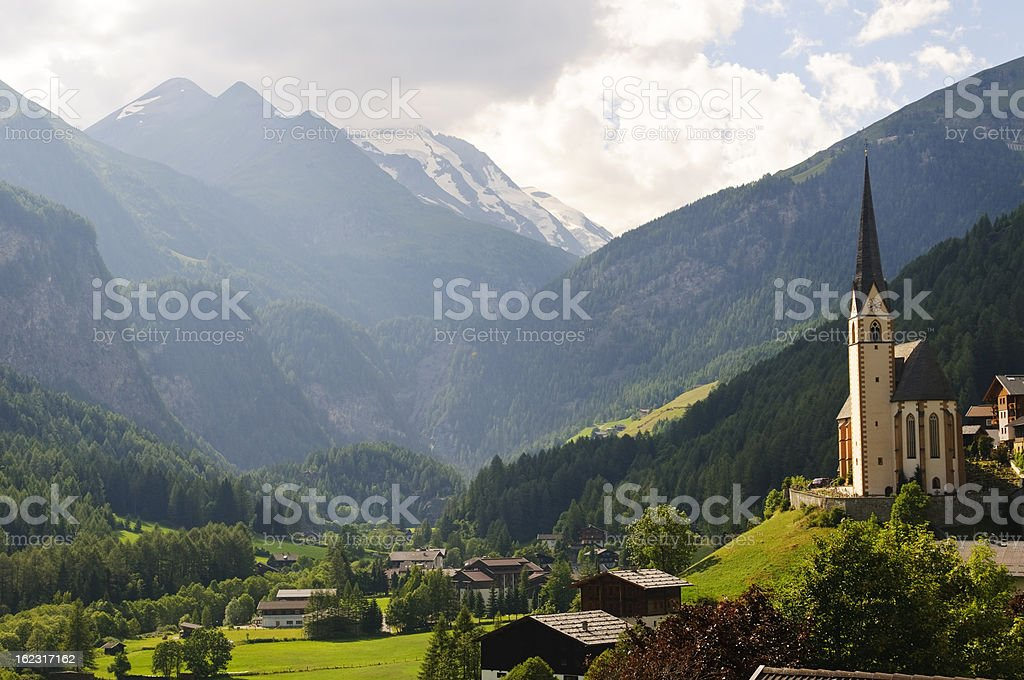 Austrian landscape and church in Heiligenblut stock photo