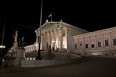 Pallas Athena fountain in front of the Austrian parliament at night, Vienna.