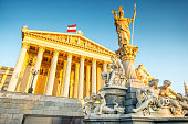 Austrian parliament building with Athena statue on the front in Vienna on the sunrise