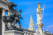 The Athena Fountain (Pallas-Athene-Brunnen) and Austrian parliament building in capital Vienna.
