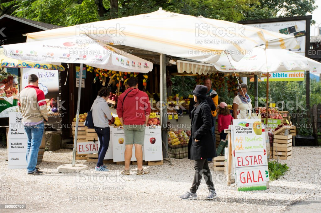 Austrian people and foreigner travelers buying food product and gift souvenir at local shop beside road in Tyrol, Austria stock photo