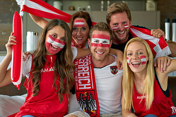 austrian soccer fans watching tv stock photo