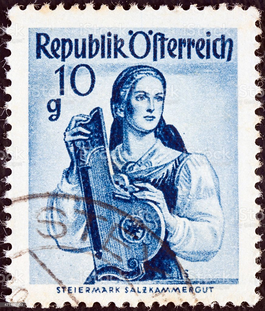 Austrian stamp shows a woman from Steiermark Salzkammergut (1948) royalty-free stock photo