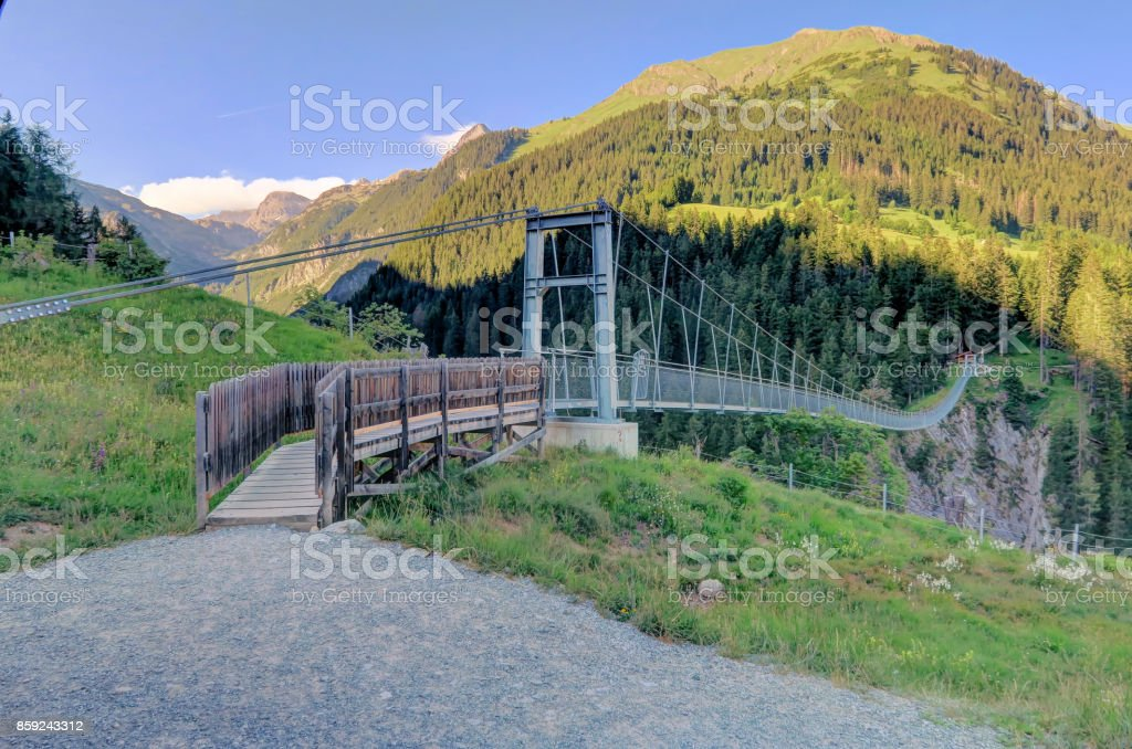 Austria's longest pedestrian suspension bridge in Holzgau Bridge of Holzgau stock photo