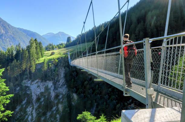 Austria's longest pedestrian suspension bridge in Holzgau Bridge of Holzgau stock photo