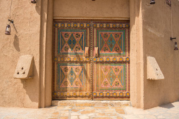Authentic Arabian style wooden door with decoration pattern in Riyadh, Saudi Arabia Authentic Arabian style wooden door with decoration pattern in Riyadh, Saudi Arabia saudi arabia stock pictures, royalty-free photos & images