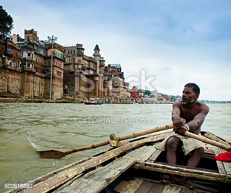 Varanasi, India - October 1, 2013: Authentic boatman on the river Ganges in Varanasi. Boat trips are one of the most popular tourist activities in Varanasi, India.
