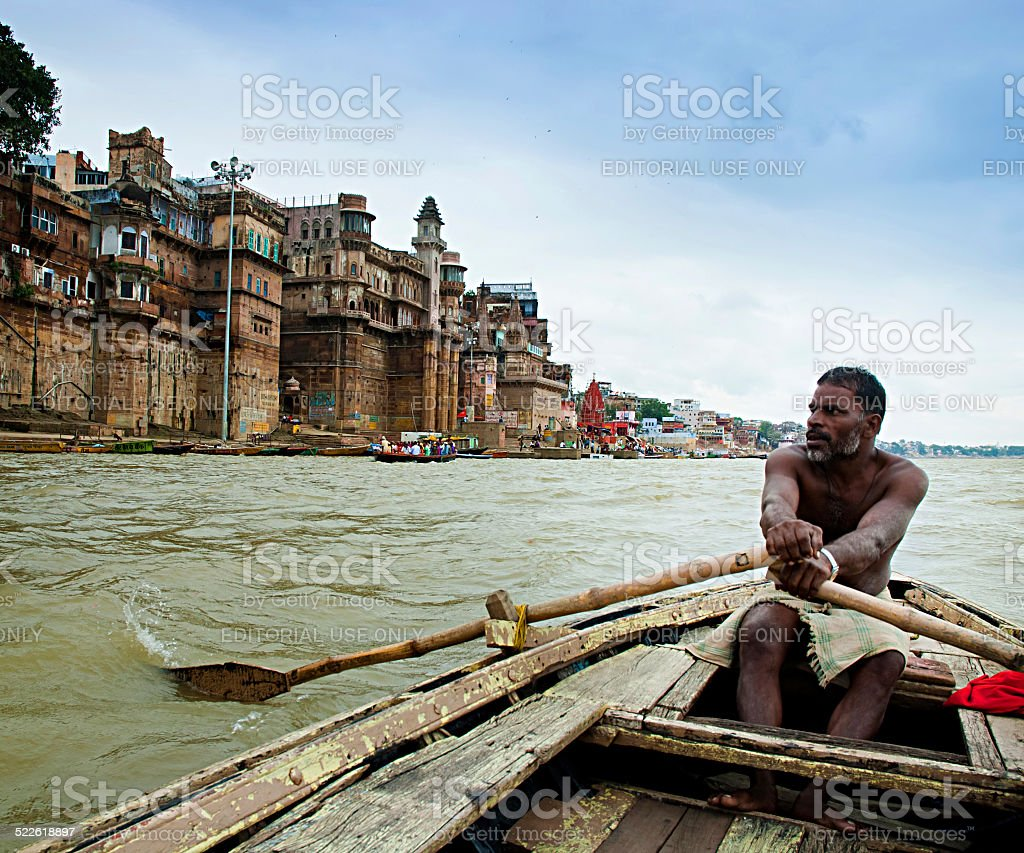 Authentic boatman on the river Ganges in Varanasi. stock photo