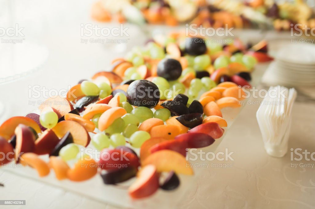 Authentic buffet, assorted fresh fruits, berries and citrus. Preparation for design creative menu stock photo