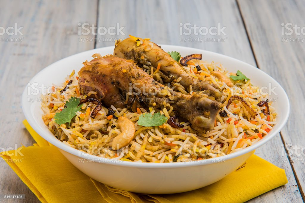 authentic chicken biryani with onion raita stock photo