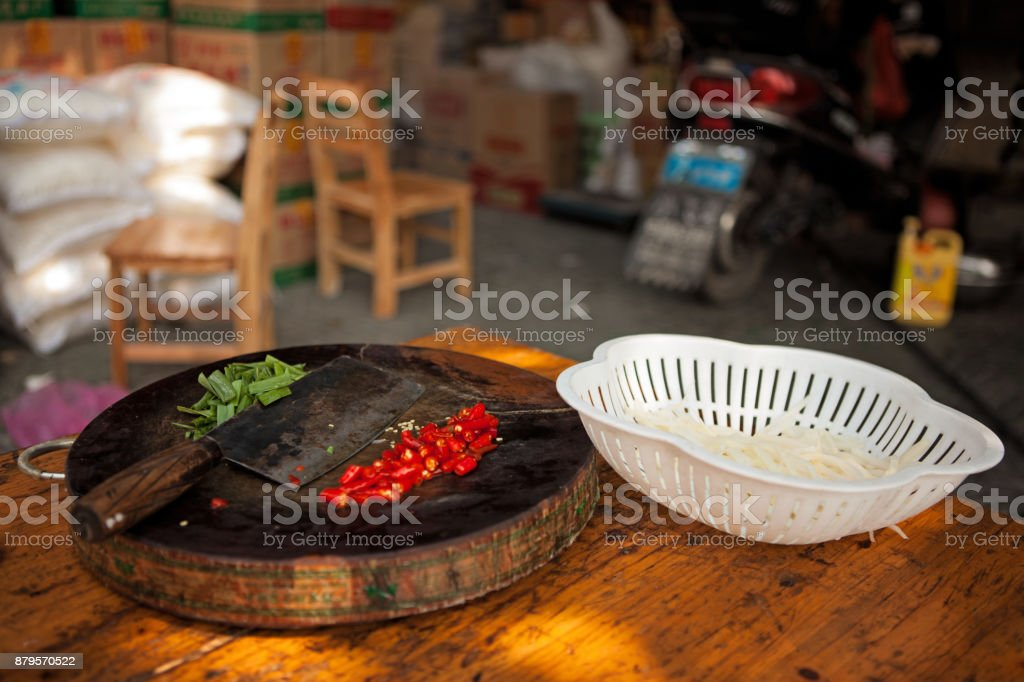 Authentic Cutting board with chillies and shallots stock photo