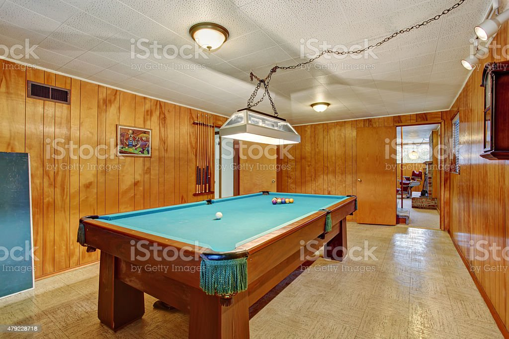 Authentic game room with pool table. stock photo