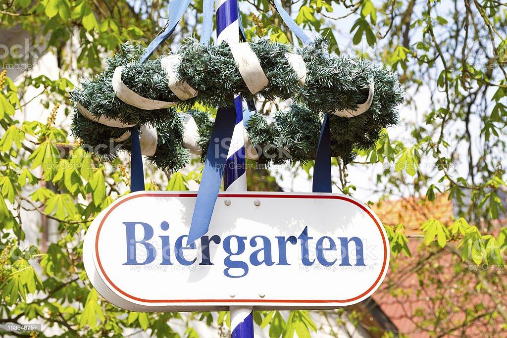 Authentic German beer garden with festive wreath stock photo