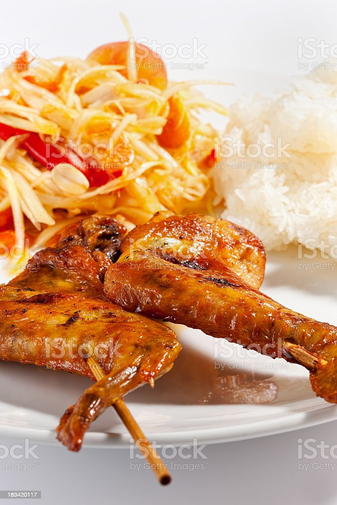 Authentic grilled Thai chicken with Papaya salad and sticky rice royalty-free stock photo