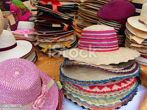Colorful Handmade Panama Hats or Paja Toquilla hat or sombrero at the traditional outdoor market in Cuenca, Ecuador. Popular souvenir from South America