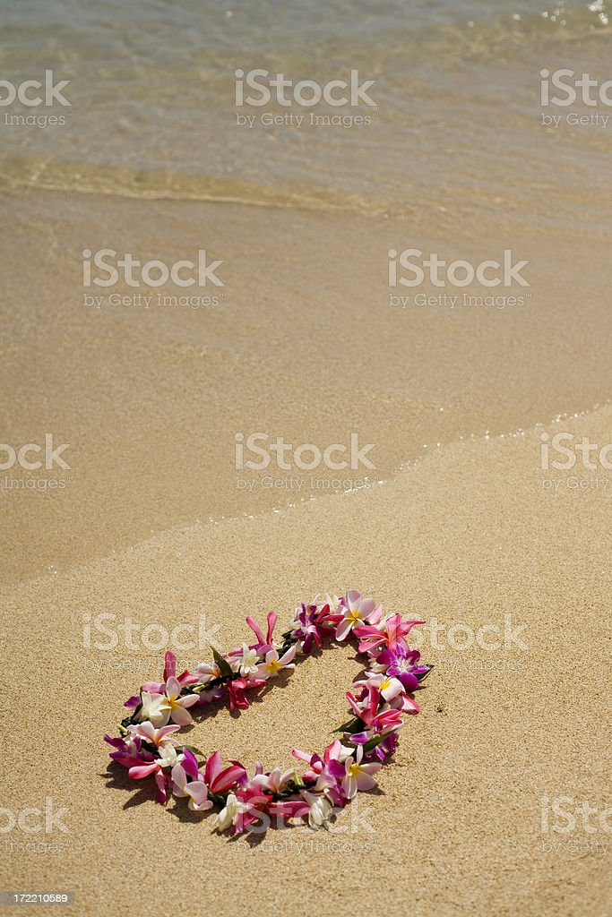 Authentic Hawaiian Lei on the Beach royalty-free stock photo