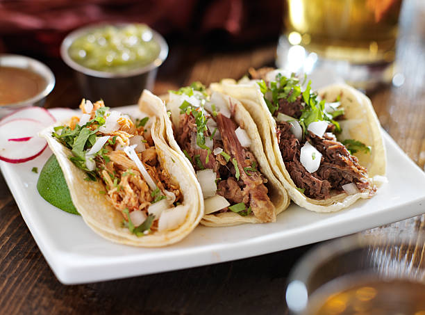authentic mexican barbacoa, carnitas and chicken tacos - mexican food stock photos and pictures
