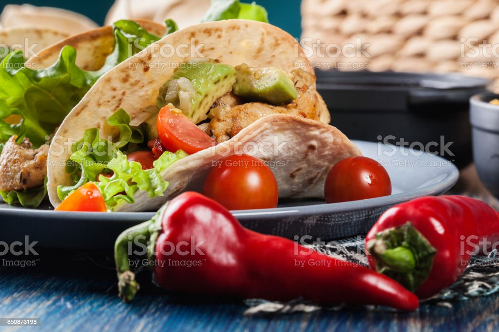 Authentic mexican tacos with chicken and salsa with avocado, tomatoes and chillies stock photo