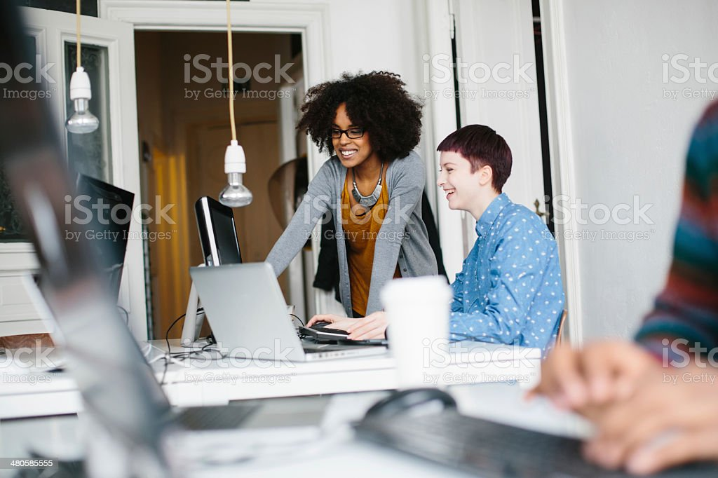 Authentic picture of entrepreneurs working together stock photo
