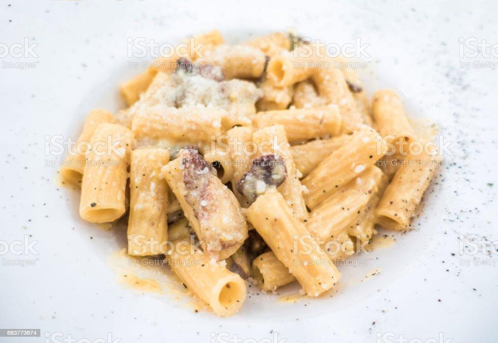 authentic recipe rigatoni spagetti a la carbonara rome roma dish trastevere stock photo