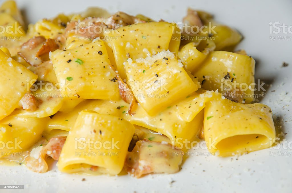 authentic traditional italian carbonara pasta with bacon and egg stock photo