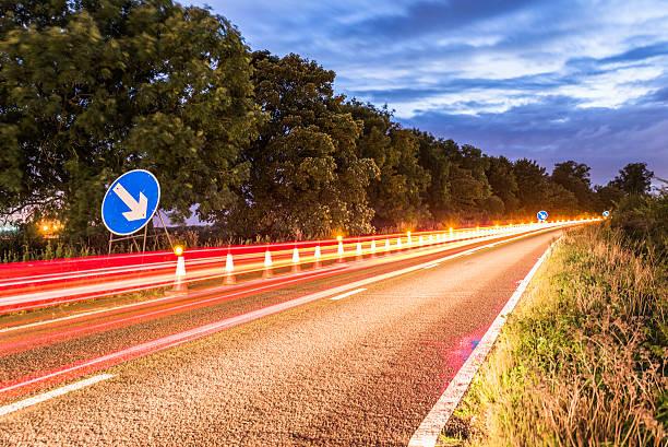 Authentic UK Motorway Roadworks Warning Traffic Cones at Night - Photo
