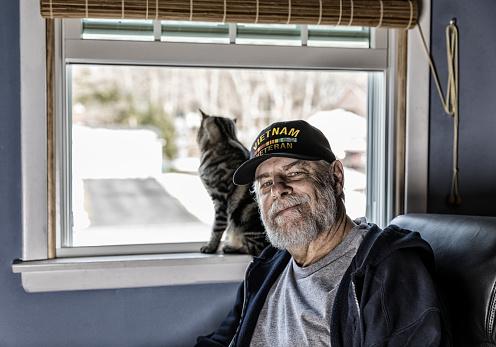 istock Authentic US Navy Vietnam War Veteran With Pet Kitten 937195862