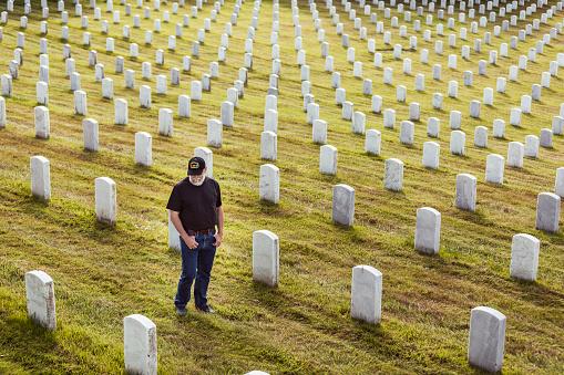 Authentic Vietnam Veteran Walking in Military Cemetary
