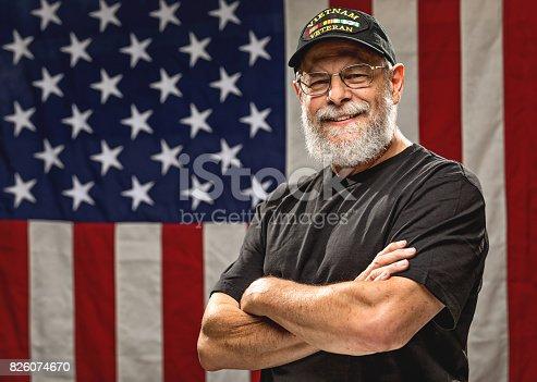 istock Authentic Vietnam Veteran with American Flag 826074670