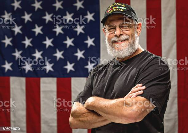 Authentic vietnam veteran with american flag picture id826074670?b=1&k=6&m=826074670&s=612x612&h=see lvrc071kt91sfqcchgh4sfwmjlwsg8gyaxgzn3m=
