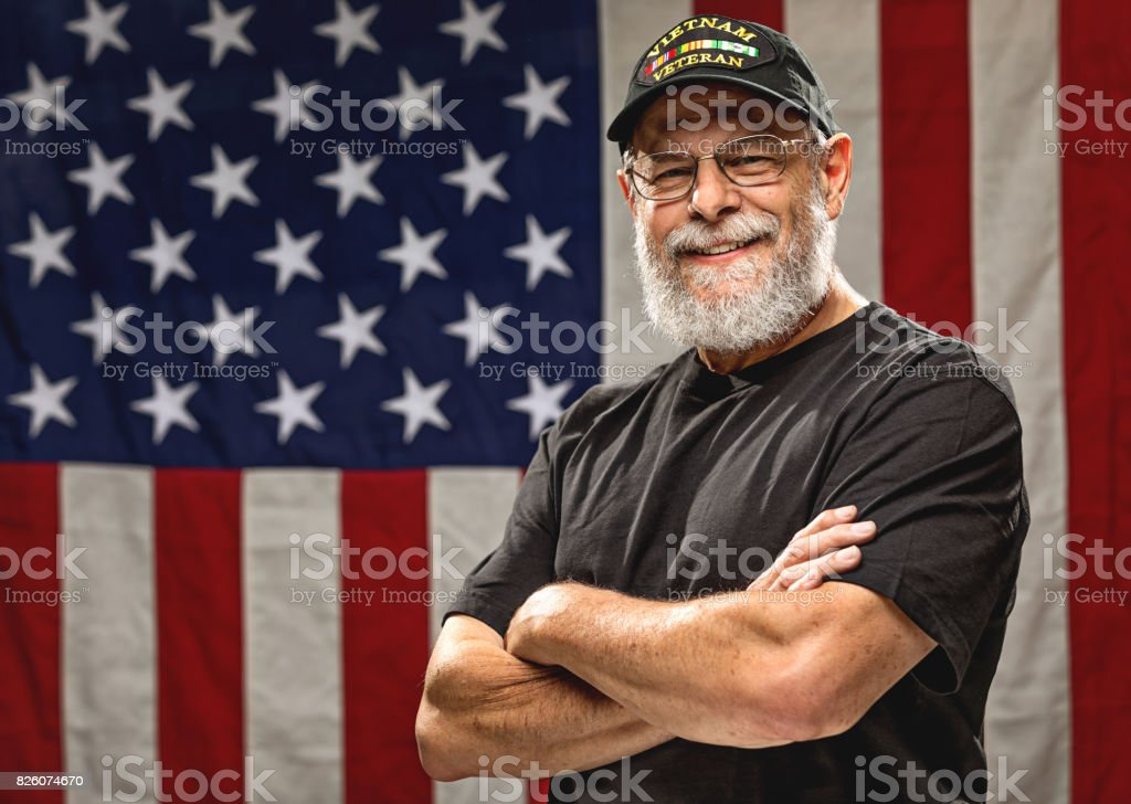 Authentic Vietnam Veteran with American Flag stock photo