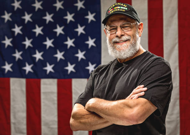 Authentic Vietnam Veteran with American Flag stock photo