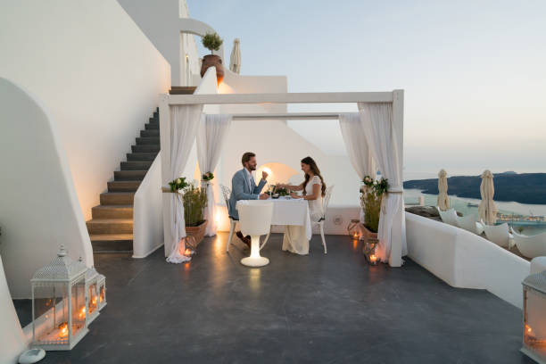 Authentic Wealth - dinner for two on private porch couple having candlelight dinner on romantic terrace with seaview honeymoon, vacation table for two stock pictures, royalty-free photos & images
