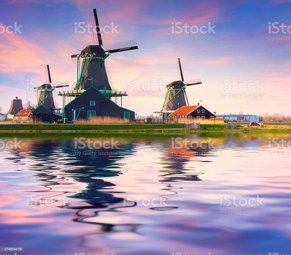 Authentic Zaandam mills on the water channel in Zaanstad willage. stock photo