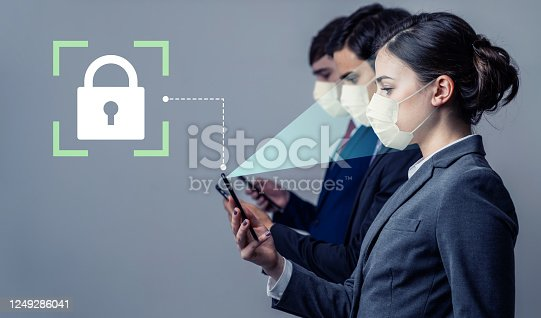 858527030 istock photo Authentication by facial recognition with surgical mask. Biometric. Security system. 1249286041