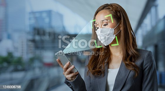 858527030 istock photo Authentication by facial recognition with surgical mask. Biometric. Security system. 1249306758