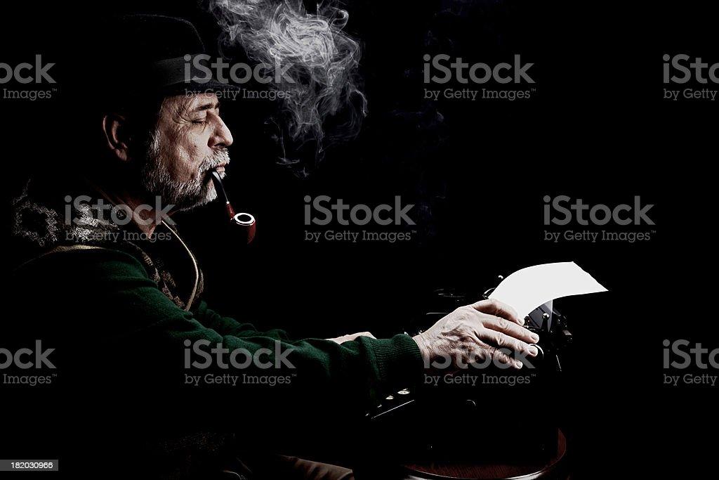 author senior man smoking pipe with typewriter stock photo