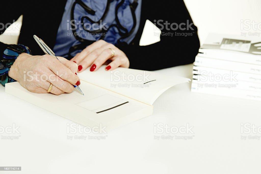 Author signing books royalty-free stock photo