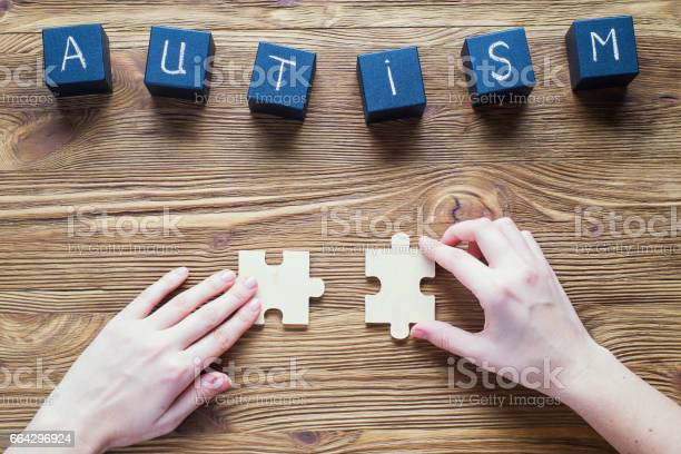 Autism awareness black wooden cubes with word autism on a wooden top picture id664296924?b=1&k=6&m=664296924&s=612x612&h= qcphhsuiduz4xumpqjep9ezm0cpmffroi3xdlbbkse=