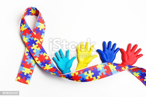istock Autism awareness concept with colorful hands on white background. Top view 929003432