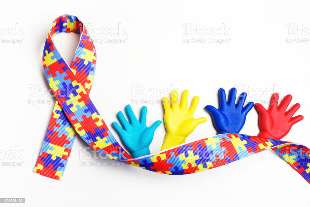 Autism awareness concept with colorful hands on white background. Top view stock photo