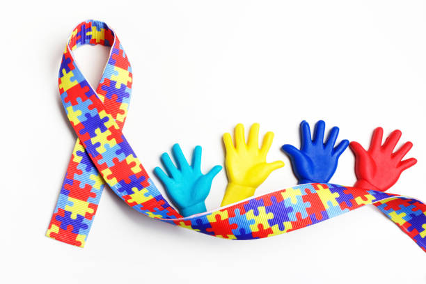 autism awareness concept with colorful hands on white background. top view - conceptual symbol stock pictures, royalty-free photos & images