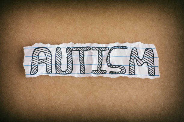 Autism. Word Autism on brown background stock photo