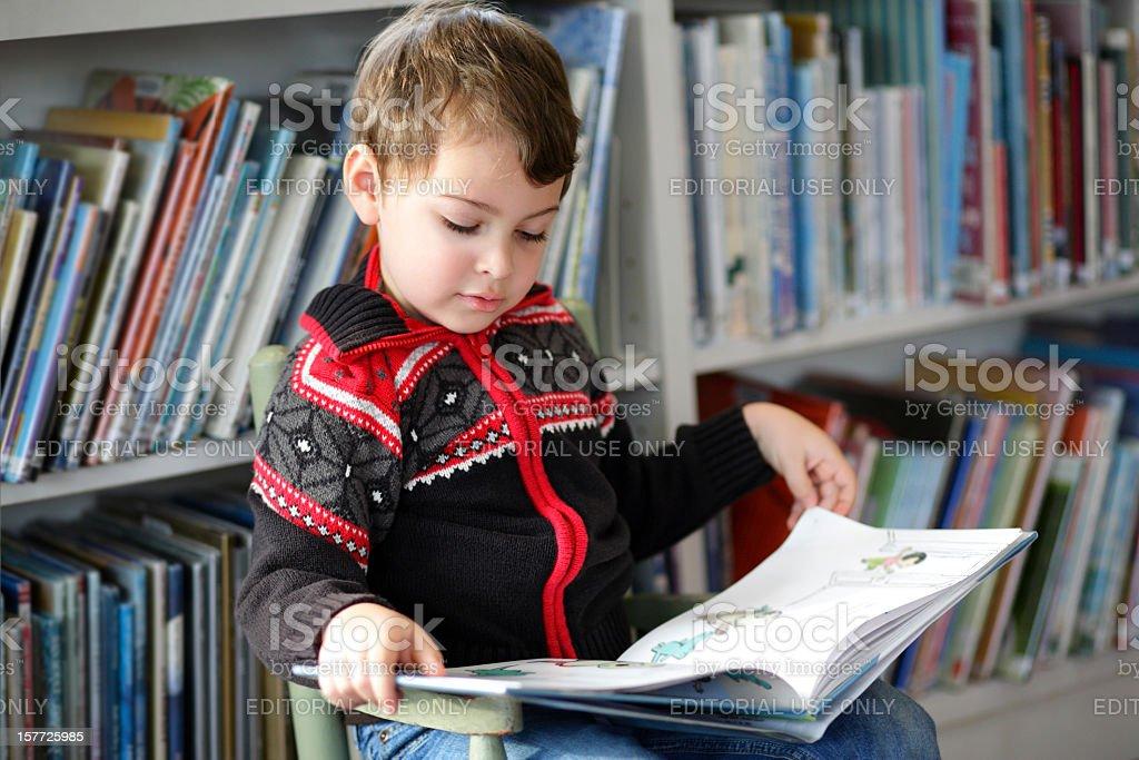 Autistic boy reading stock photo