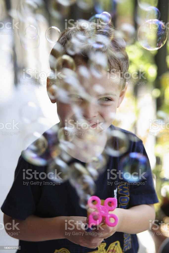Autistic boy with bubble wand stock photo