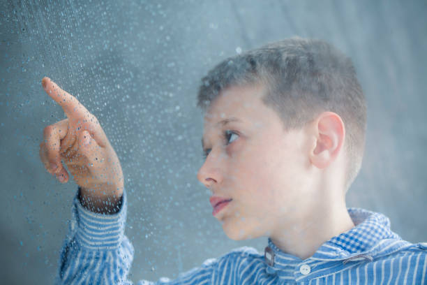 autistic child counting raindrops - autism stock photos and pictures
