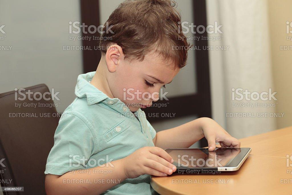 Autistic child using an iPad stock photo