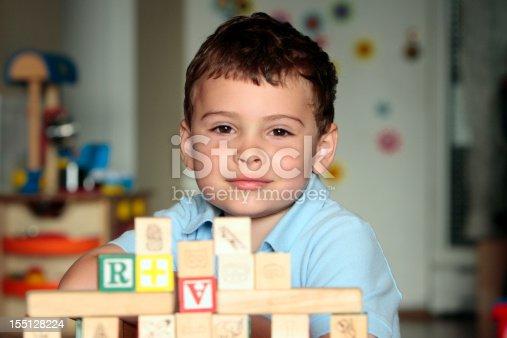istock Autistic child with toy blocks 155128224