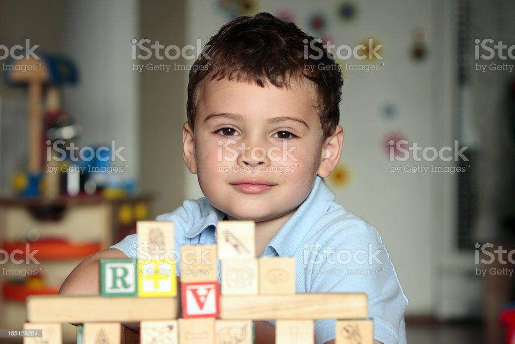 Autistic child with toy blocks stock photo